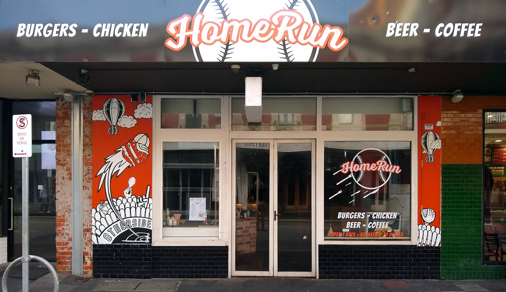 Mural of baseball burger being hit for a homerun on the front of a burger shop.